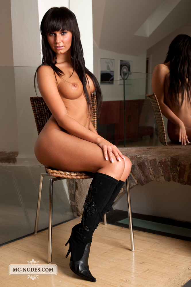 Carie on chair in front of mirror
