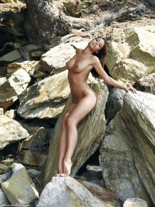 Tonya Tyler lying on the rocks