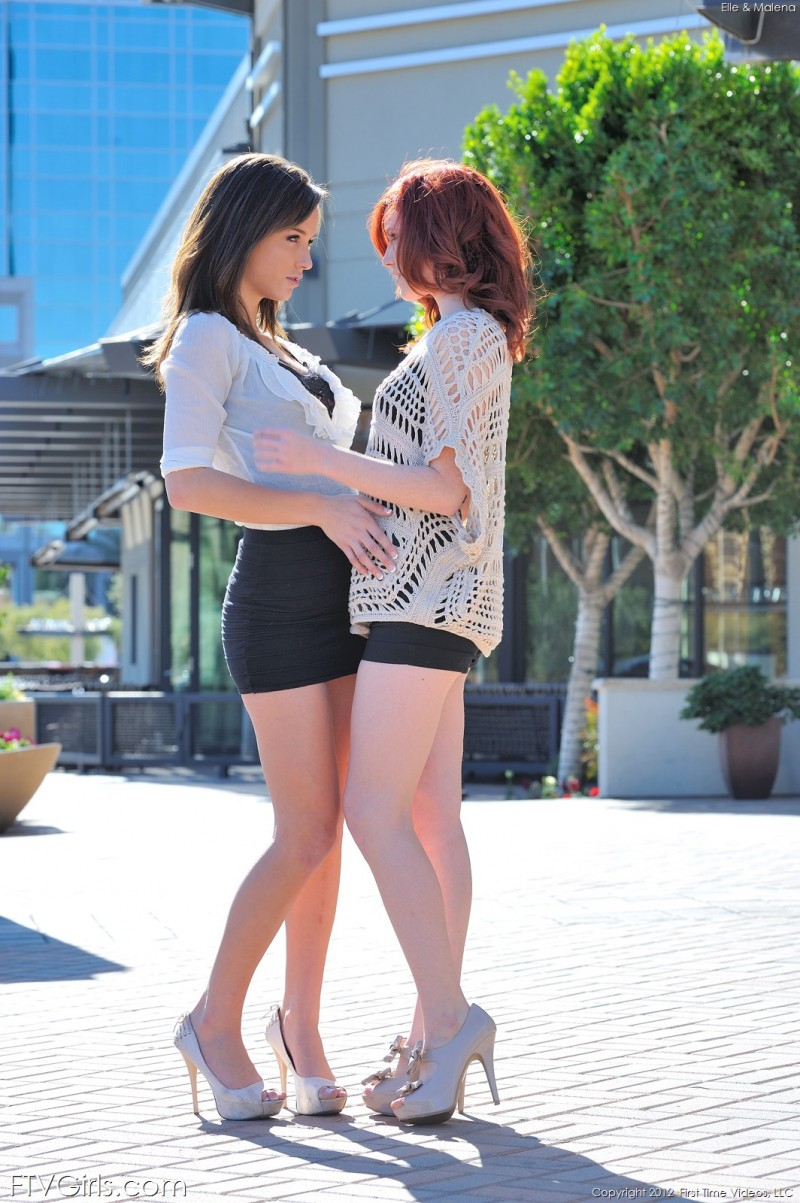 Elle and Malena strips outdoors
