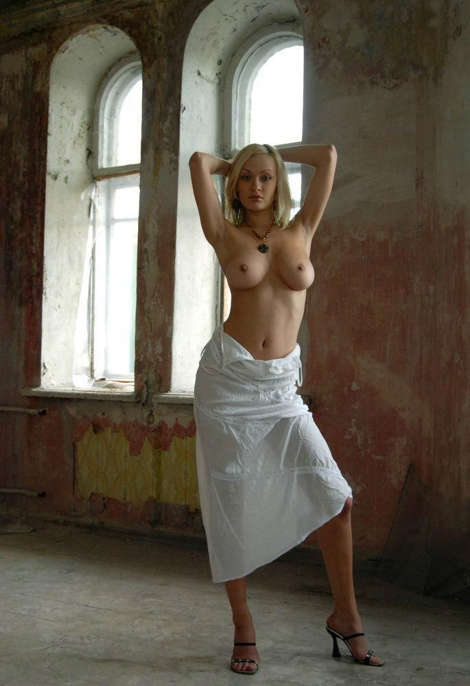 Poor blonde girl in abandoned house