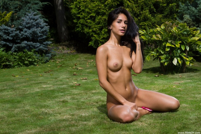 Malina naked on the lawn brunette Malina public small tits