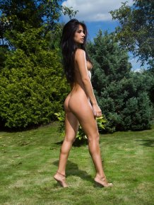 Malina naked on the lawn