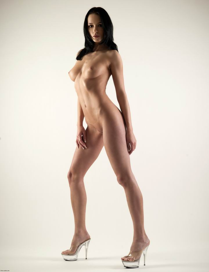 Naked brunette on high heels