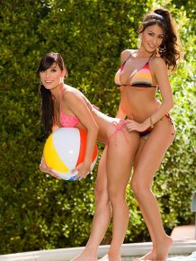 Anna Lynn and Jessica Erin Sylvia by the pool