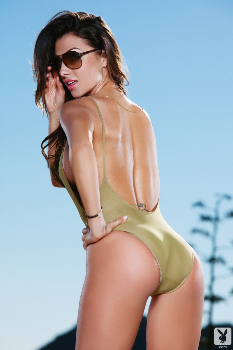 Casey Connelly in one piece swimsuit