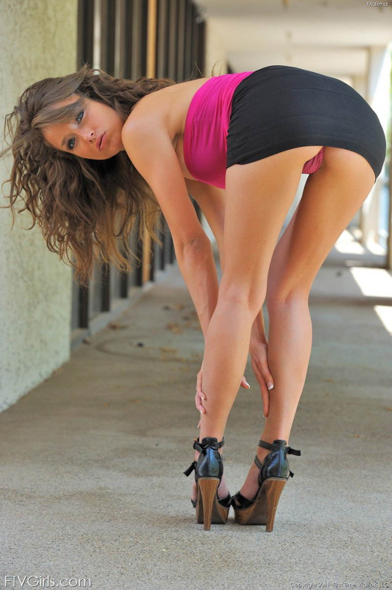 Malena Morgan strips outdoors