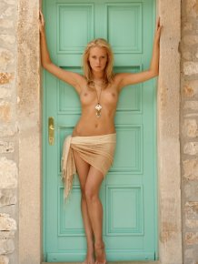 Denisa Markova is naked at the door