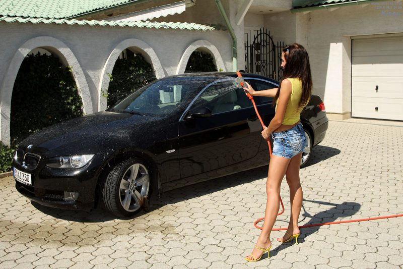 Kissy washing her BMW