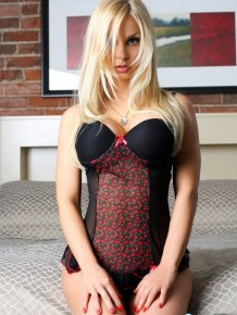 Jenny Poussin strips on bed