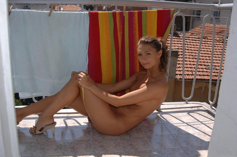 Naked amateur girl on balcony