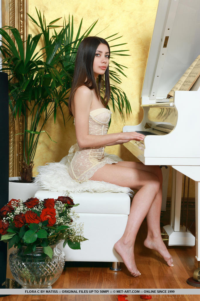 Flora playing the piano flora c long hair piano skinny Young girls