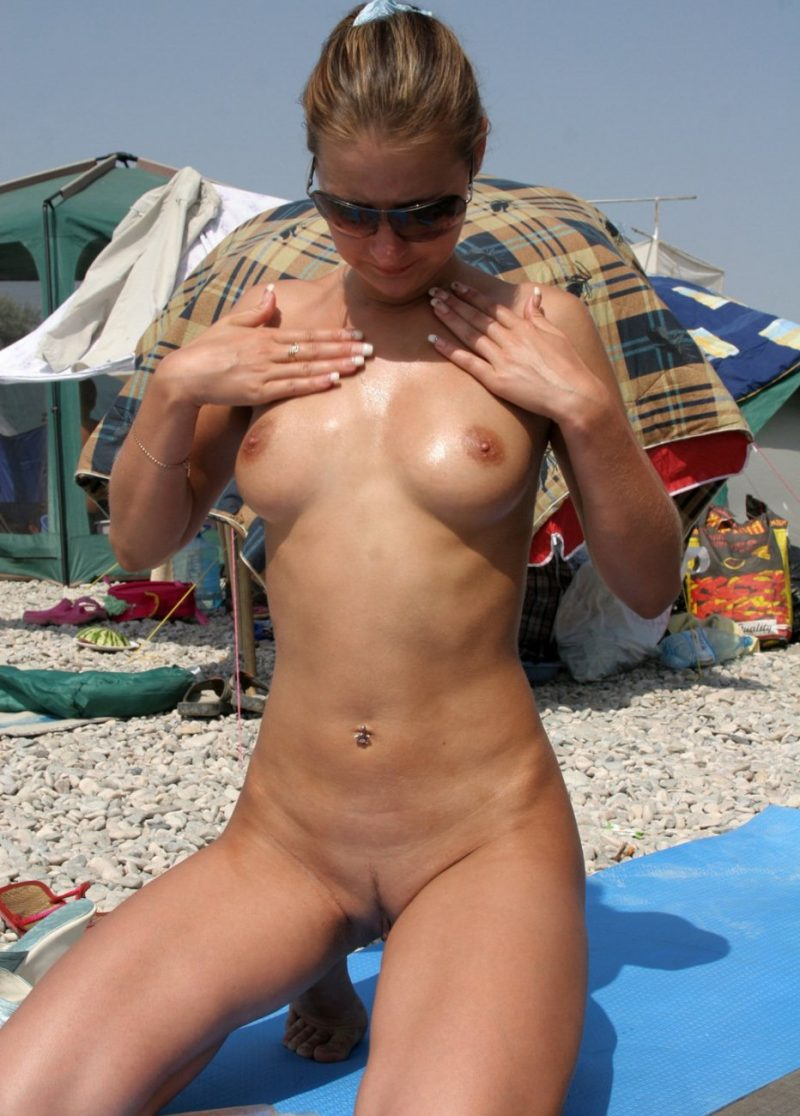 Two nudist girlfriends on the beach