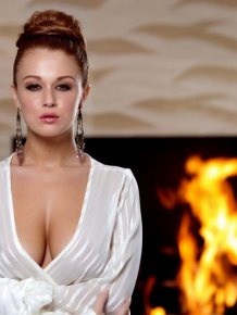 Leanna Decker by the fireplace