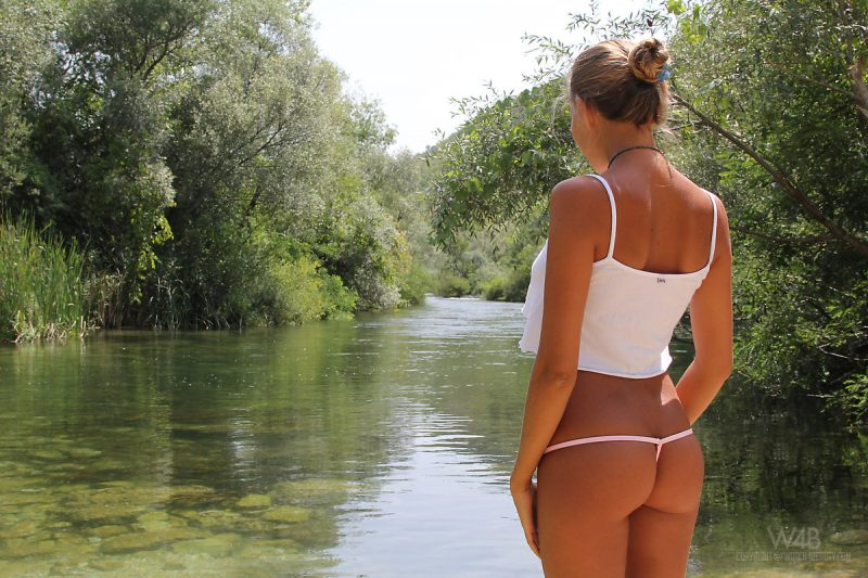 Katya Clover swimming in the river