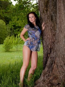 Karina nude under the tree