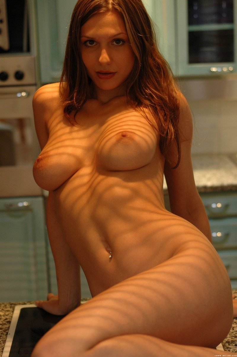 Nadine naked on kitchen counter