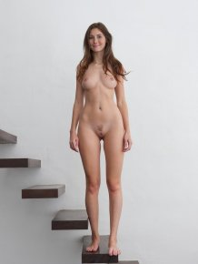 Kattie Gold nude on stairs