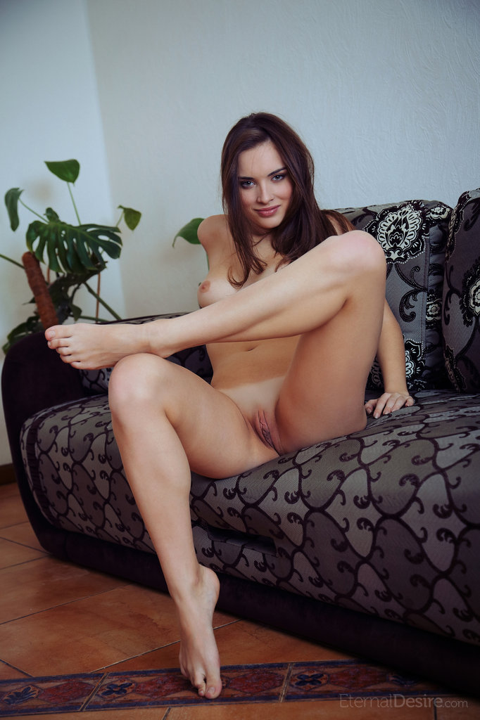 Natalie B nude on the sofa