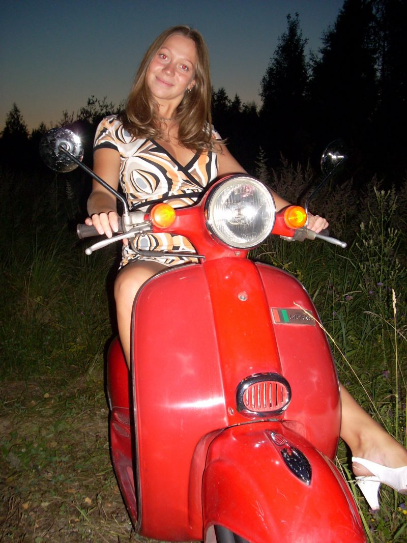 Chubby girl naked on scooter