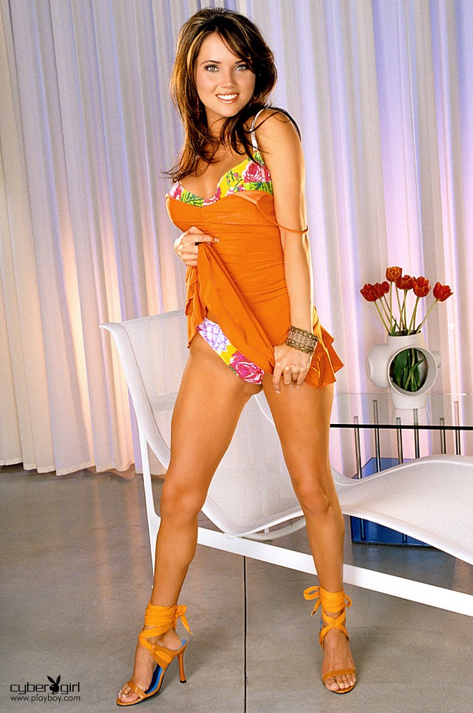 Stephanie Larimore in orange dress