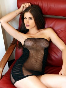 Little Caprice in fishnet dress