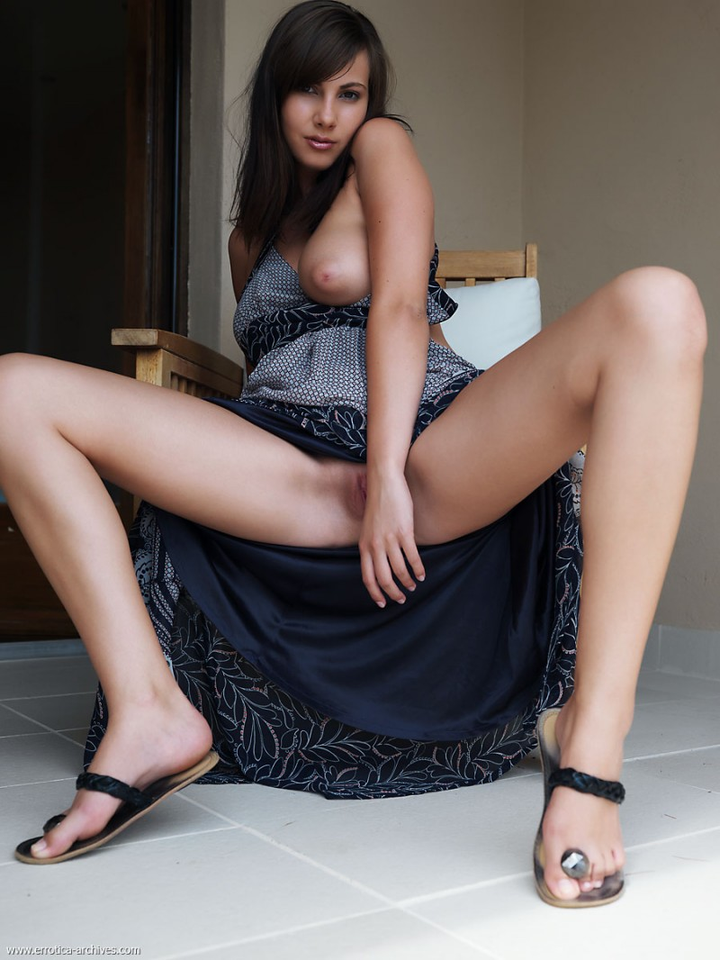Conny - armchair on the balcony big tits brunette Conny public